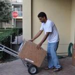 Bernie James, Ephraim Romero & Maxwell Ditta pack computers for shipment